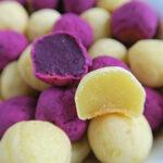 Bowl full of purple and white sweet potato mochi balls