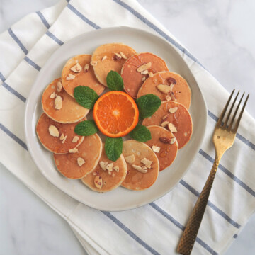 mini pancake with orange and mint.
