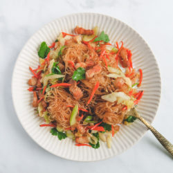 stir fry mung bean noodles with pork belly and vegetable on a plate..