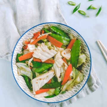 stir fry cabbage with carrots and snow peas.