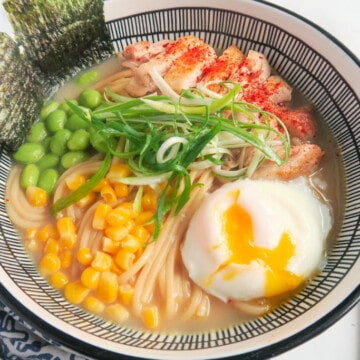 a bowl of chicken ramen noodle with egg and veggies closer look.