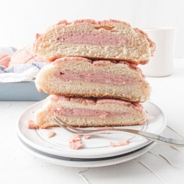 a stack of strawberry pineapple bun with cream cheese filling. .