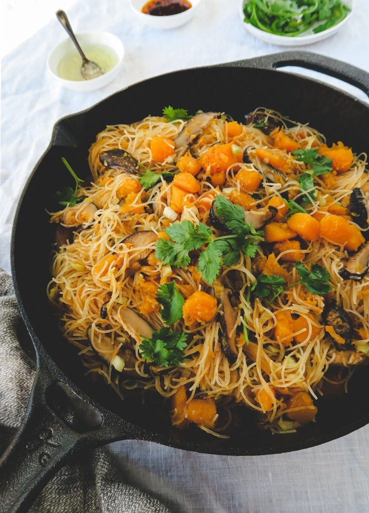 Cast iron skillet with butternut squash, rice noodles, and shitakke mushrooms.