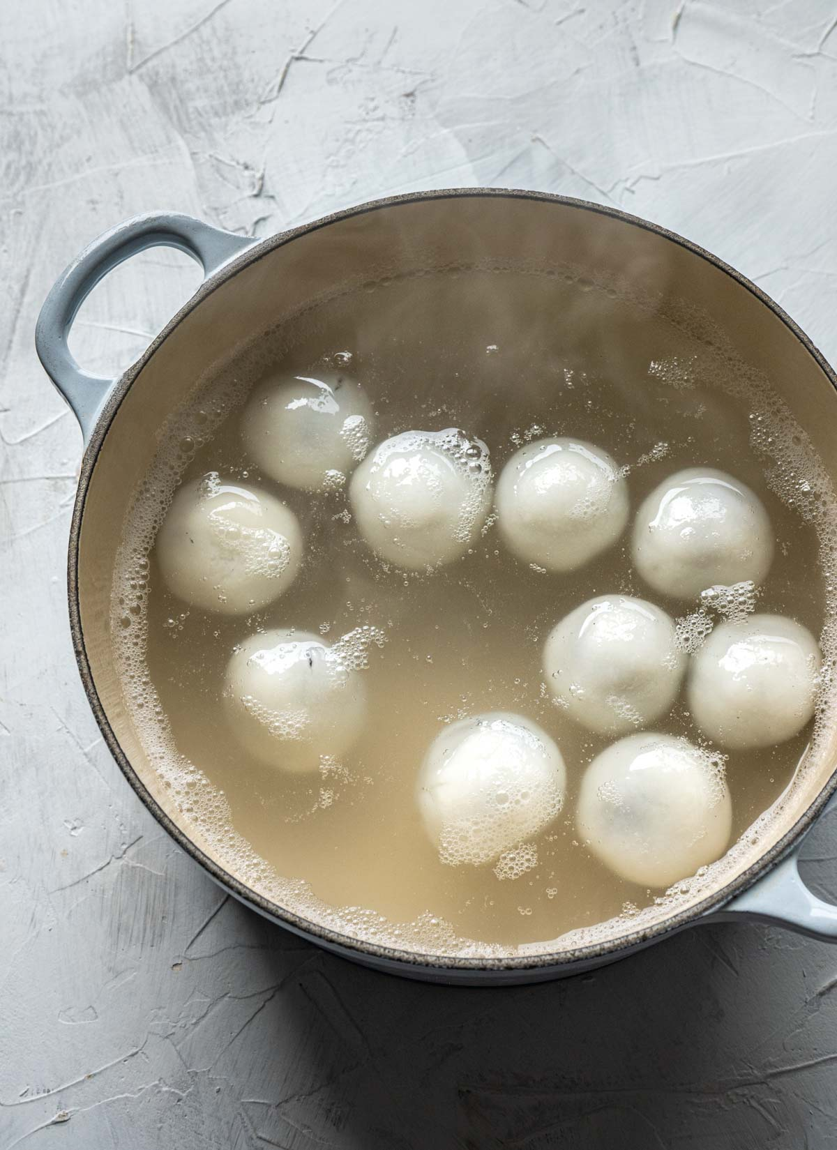 cooking tang yuan in a Dutch oven.