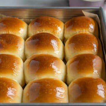 milk buns in a baking pan.