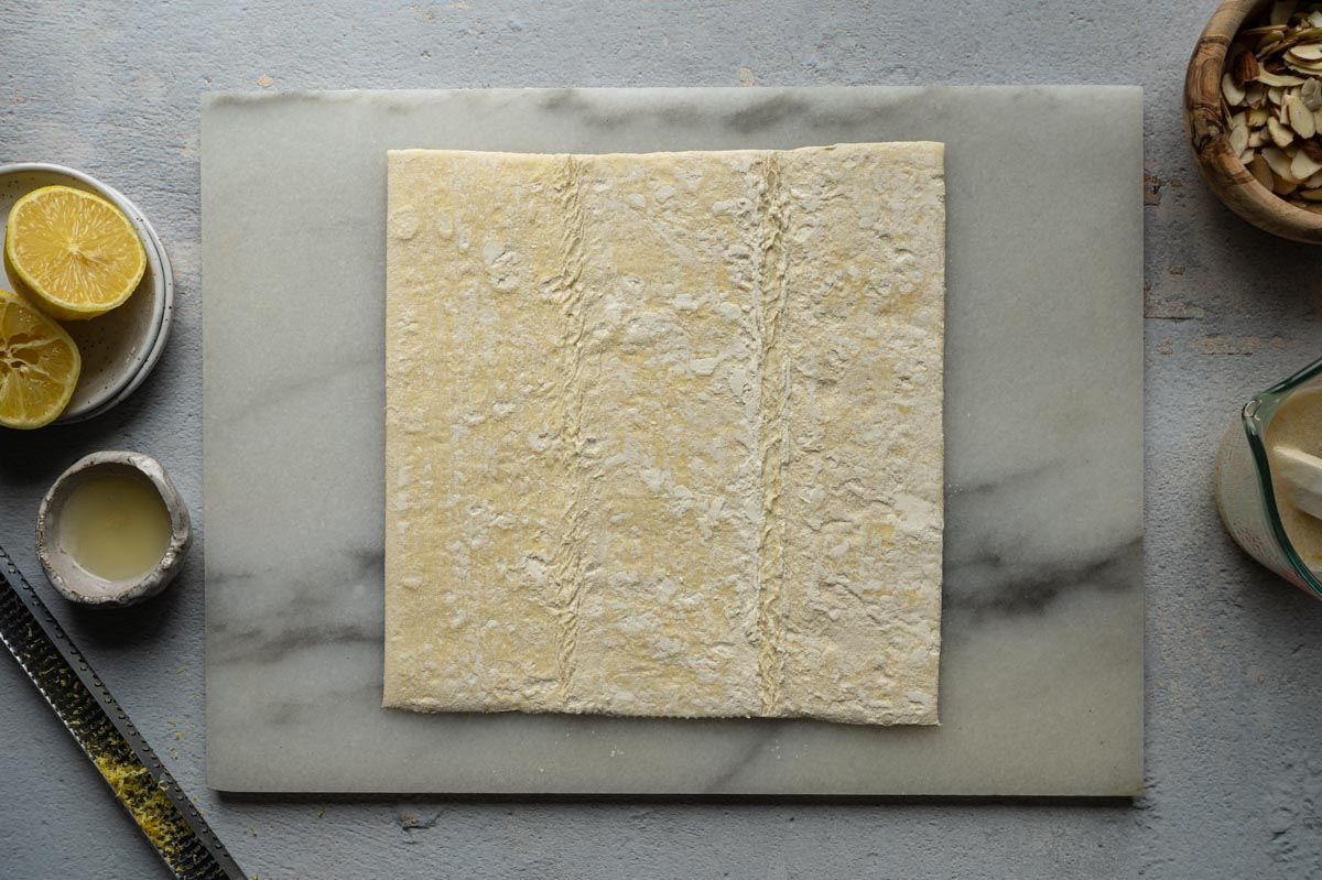 puff pastry sheet on a marble board.