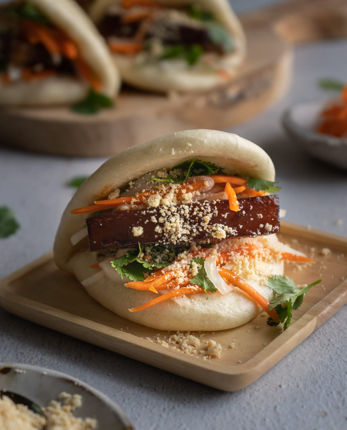 Gua bao on a wooden plate.