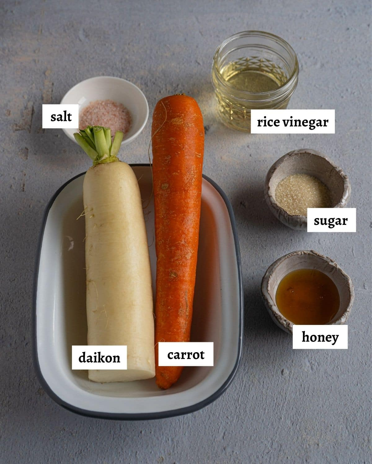 ingredients for making pickled carrots and daikon.