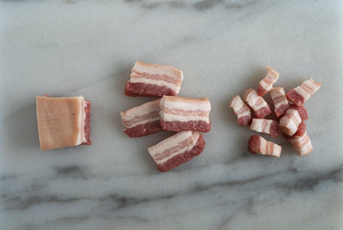 chopping pork belly.