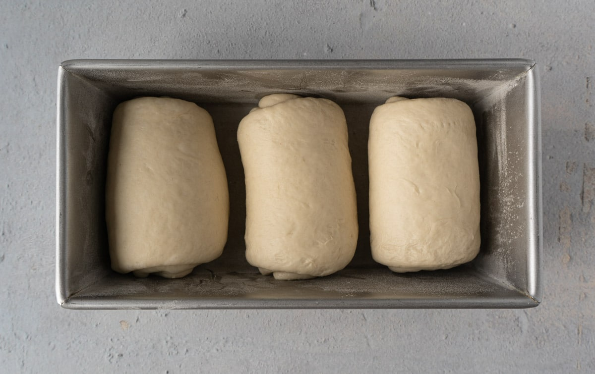 Milk bread dough in the loaf pan.