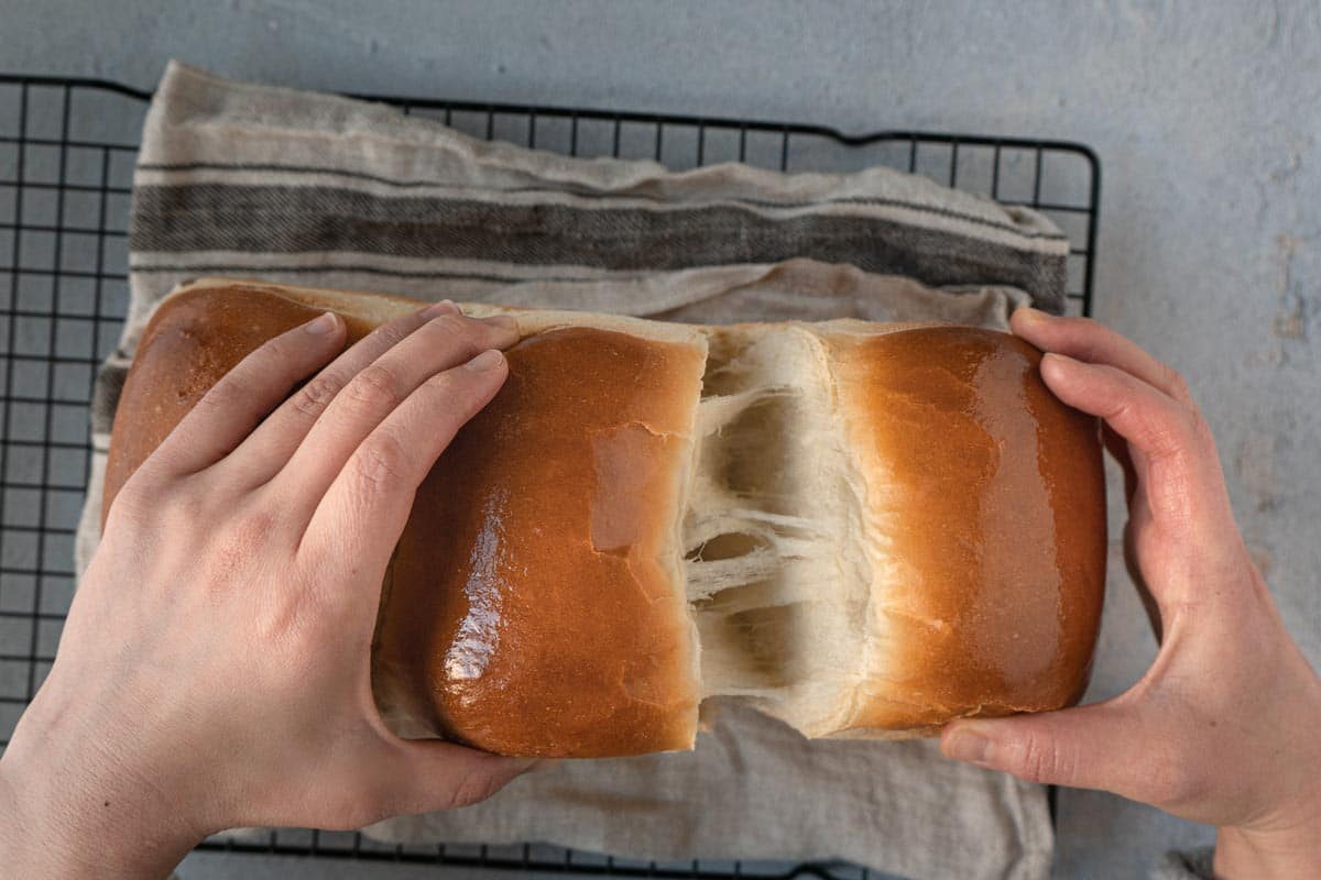 Pulling milk bread apart.