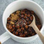 Brown sugar boba pearls in a white sauce pan.