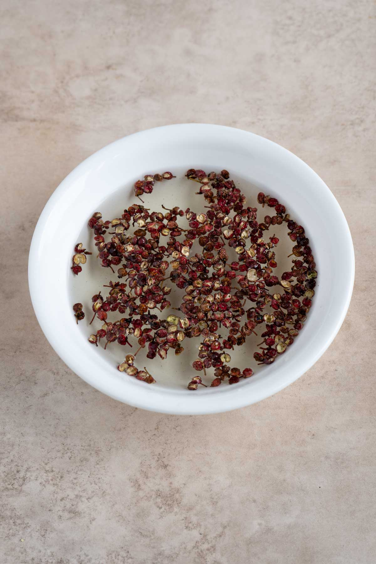 Sichuan peppercorn soaked in water,