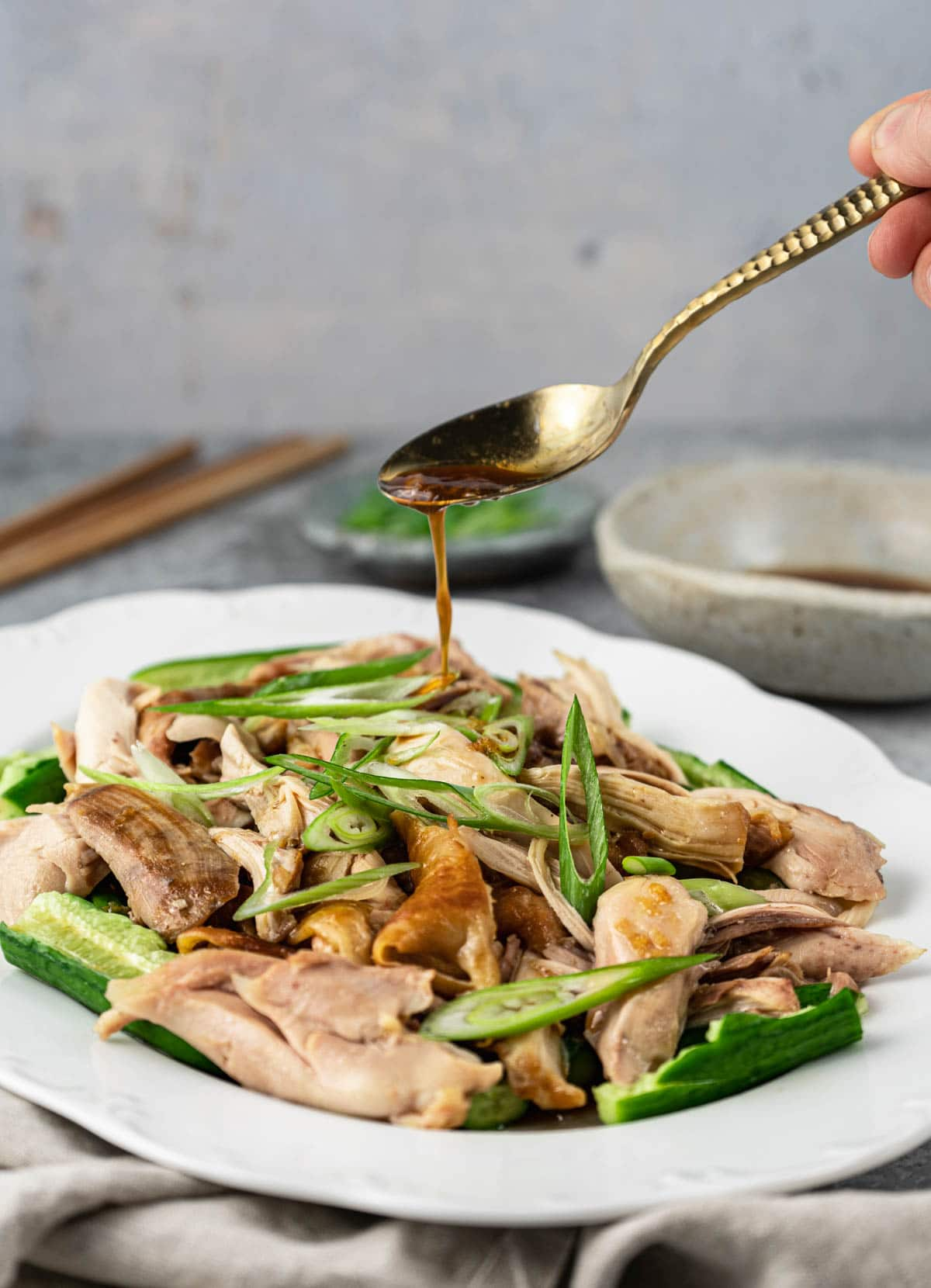 Drizzle dressing on Shandong chicken.