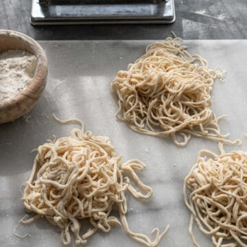 Three piles of handmade noodles.